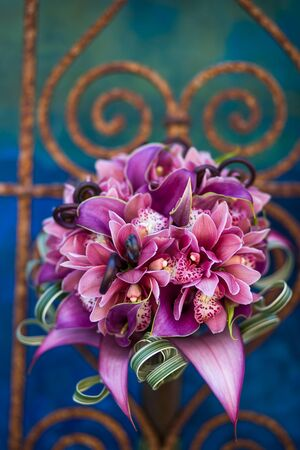 blue green background: Closeup of a vibrant modern bouquet of flowers