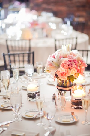 table decoration: Floral centerpiece on a table at a wedding reception