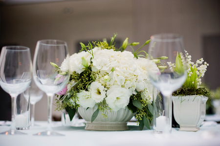 Overhead view of a floral centerpiece on a table at a formal event