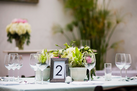 centerpiece: Floral centerpiece on a table at a formal event