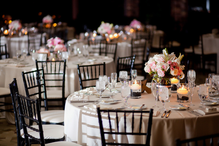 centerpiece: Tables with centerpieces at wedding reception