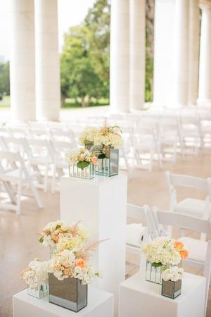 aisle: Flowers near the aisle of an elegant wedding ceremony