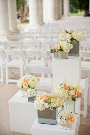 Flowers near the aisle of an elegant wedding ceremony
