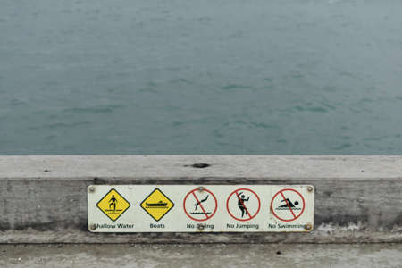 Warning signs at the edge of the pier