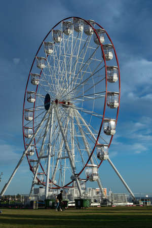 ST KILDA, MELBOURNE, AUSTRALIA - 7 April 2019: The Skyline St Kilda Ferris Wheel in the afternoon on a sunny day.