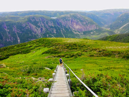 Hiking in beautiful Gros Morne National Park atop Gros Morne Mountain in Newfoundland and Labrador, Canada 写真素材 - 106381662