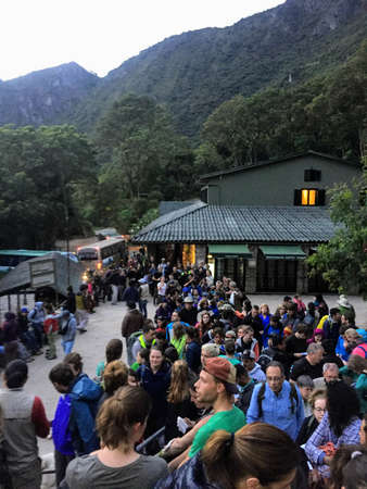 Machu Picchu, Peru - May 10th, 2016 -A crowd of tourists waiting in line to enter Machu Picchu just before sunrise.  Many hiked through the hills from Aguas Calientes in the dark to get a spot in line