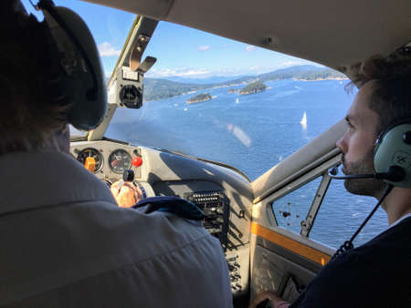Gulf Islands, British Columbia, Canada - August 17th, 2017: A small float plane en route from Vancouver to Saltspring Island.  The trip provides gorgeous aerial views of the islands and ocean below. Redactioneel