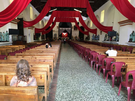 Santiago Atitlan, Guatemala.  May 20th, 2018:  A handful of people pray at the otherwise empty church on a very hot day in May. Redakční