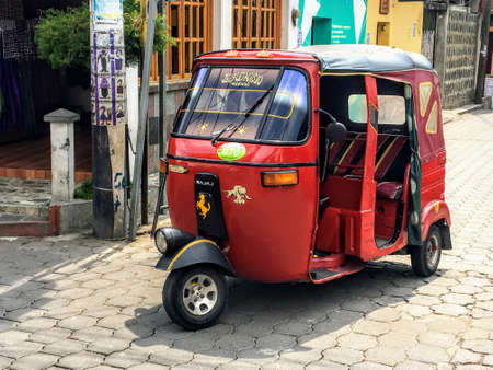 Antigua Guatemala, Guatemala - May 20th, 2018: A closeup view of a tuk tuk on the streets of Antigua.  This is a common form of transportation for taxiing from place to place in Guatemala