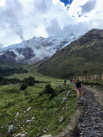 Salkantay, Trail, Cusco Province, Peru - A young group of international hikers, led by their local Inca guide, navigate the Andes mountains on the Salkantay Trail towards Machu Picchu. Фото со стока