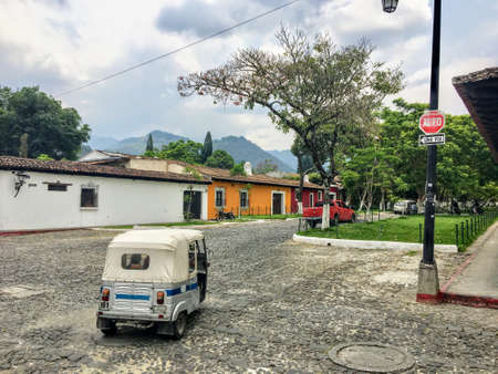 Antigua Guatemala, Guatemala - May 23rd, 2018:  A tuk tuk on the cobblestone streets of Antigua, Guatemala.  This is a common form of transportation for tourists traveling from place to place . Editorial