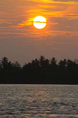 mekong: sunset over the mekong