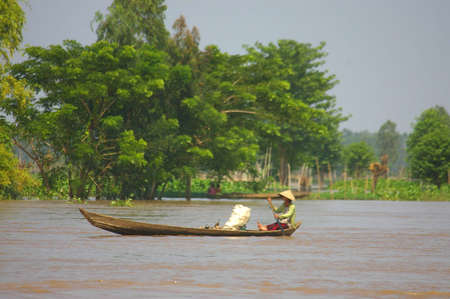 local supply: boat on the mekong river