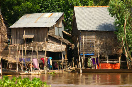 polluted river: houses on stilts, vietnam