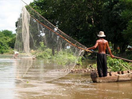 fisherman on the mekong Stock Photo - 935299
