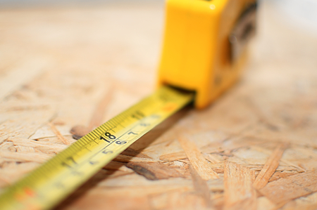 Tape measure with narrow focus on 18 inches