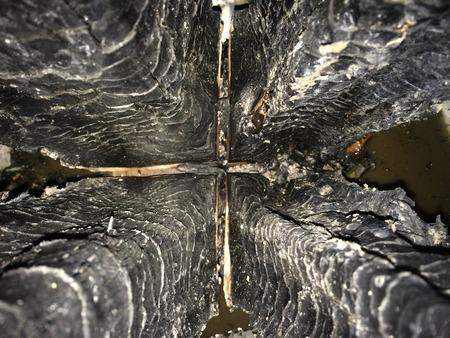 Swedish log. Burned and extinguished Stock fotó