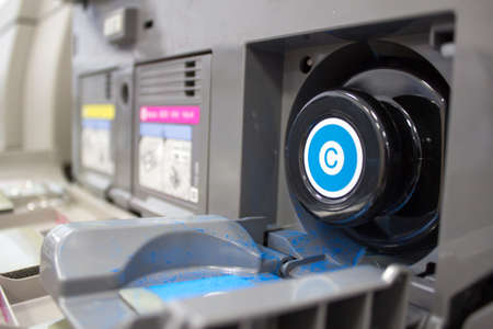 replaced: CMYK toner cartridges in photocopier, with cyan being replaced Stock Photo