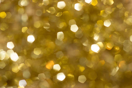 edel: Blurred gold sparkles, with defocused christmas lights Stock Photo