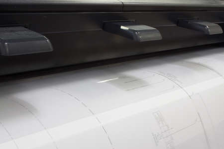 A CAD plotter printing a drawing shot from the left photo