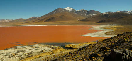 Red Lagoon in Salar de Uyuni, Peru. Stock Photo