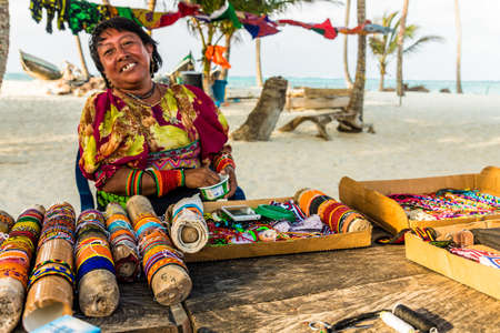 San blas islands, Panama. March 2018. A view of a local Kuna yala lady dressed in traditional clothes and selling her wares in the san Blas Islands, Panama. Editöryel