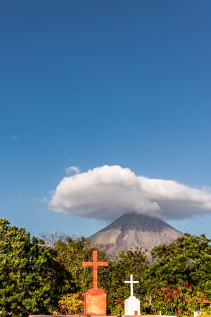 A view of the Volcano Concepcion with a religious icons in the foreground on ometepe island in Nicaragua.