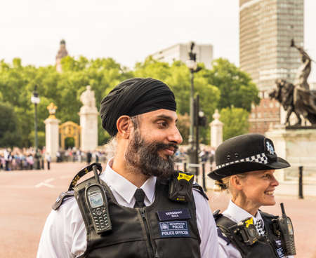 London. June 9 2018. A view of an asian and female police officer during the Queens birthday celebrations of Trooping the Colour