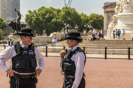 London. June 9 2018. A view of 2 female police officers during the Queens birthday celebrations of Trooping the Colour.