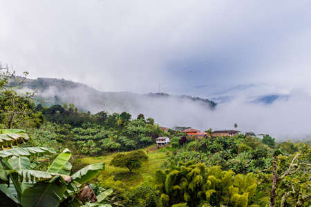 A view of the landscape from the top of the hill of the Garrucha wooden cable car viewpoint in the picturesque town of Jardin in Colombia. Stock Photo