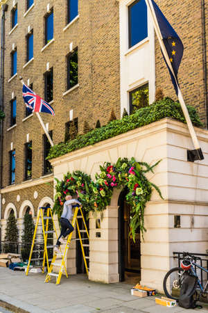 London. May 2018. A view of workman putting up decorations at the halkin hotel london