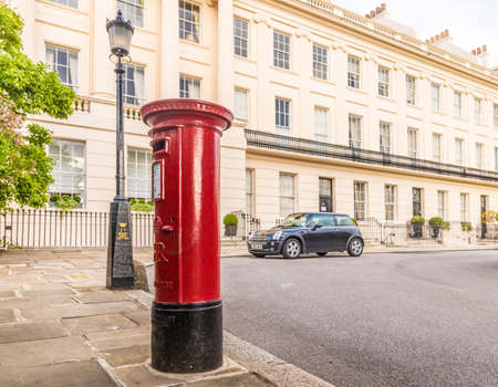 London. August 2018. A view of a red post box and grand architecture in Regents Park in London