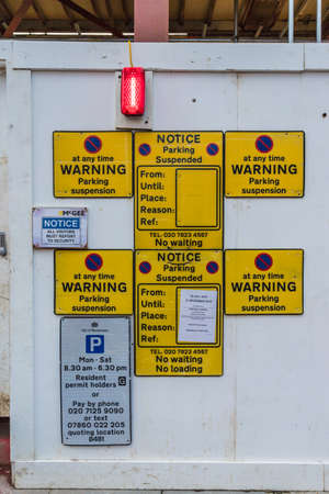 London November 2018. A view of no parking signage on a construction hoarding at a McGee site in London Redakční