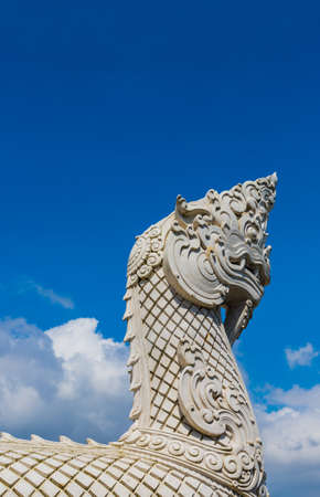 A serpentine dragons head at the big buddha statue in Phuket Thailand