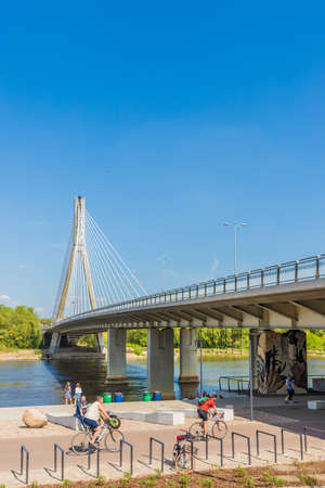 Warsaw Poland. April 2019. A view of the Swietokrzyski Bridge by the Vistula River in Warsaw in Poland Editöryel