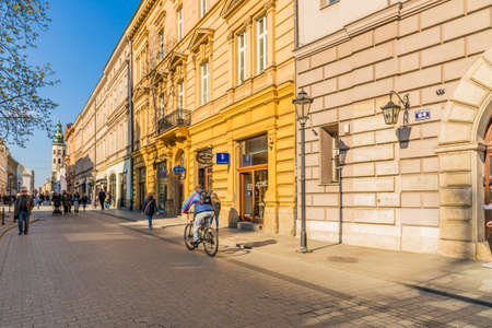 Krakow Poland. April 2019. A street scene with people in the medieval old Town in Krakow