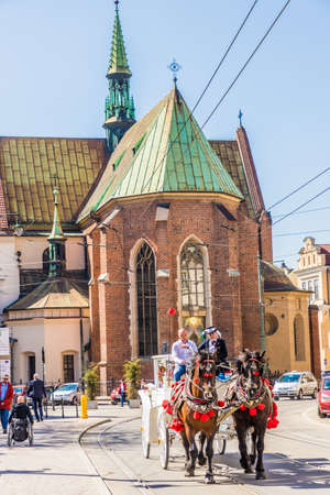 Krakow Poland. April 2019. A view of a horse drawn carriage riding through the medieval old town in Krakow