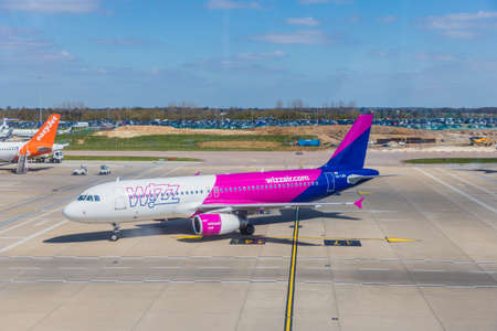 London Luton, England. pril 2019. A view of a Wizz air plane at Luton Airport in the UK