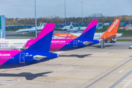 London Luton, England. pril 2019. A view of an easyjet and Wizz air plane at Luton Airport in the UK Editorial