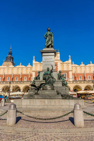 Krakow Poland. April 2019. A view of the Adam Mickiewicz Monument and Cloth Hall in the medieval old town square in Krakow