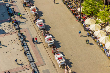 Krakow Poland. April 2019. An elevated view over the medieval old town feturing horse drawn carriages in Krakow Poland