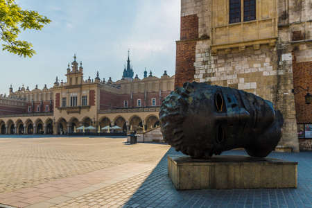 Krakow Poland. April 2019. A view of the sculpture Eros by Igor Mitoraj in the medieval old town square in Krakow Editorial