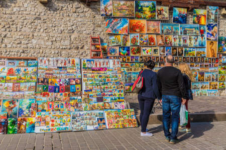Krakow, Poland. 8 May 2019. People at an outdoor gallery by Florians Gate in Krakow old town