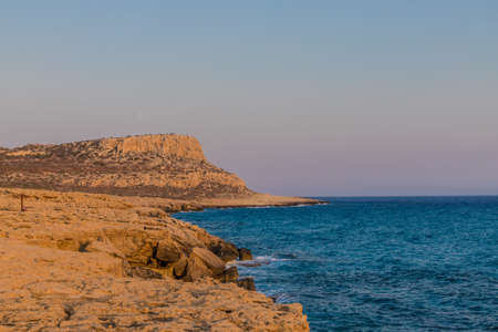 Cape Greco Cyprus. 13 August 2019. A landscape view at sunset at Cape Greco in Cyprus 스톡 콘텐츠 - 131958392