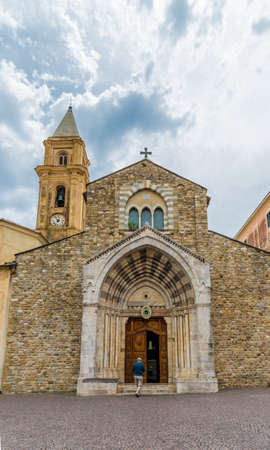 Ventimiglia Italy. June 14 2019. A view of a person walking into Cattedrale di Santa Maria Assunta in the medieval old town in Ventimiglia in Italy