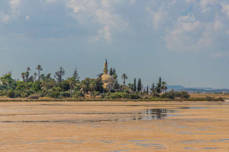 Larnaca Cyprus. 16 September 2019. A view of Hala Sultan Tekke mosque at Larnaca Salt Lake in larnaca in Cyprus Фото со стока
