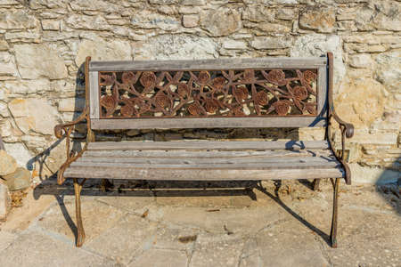 Lania Cyprus. September 3 2019. A view of a traditional wooden bench in the traditional village of Lania in Cyprus Фото со стока