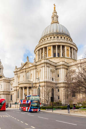 London. February 2020. A bus driving past St Pauls Cathedral, London