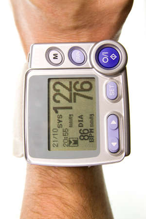 diastolic:  Wrist blood pressure monitor Stock Photo